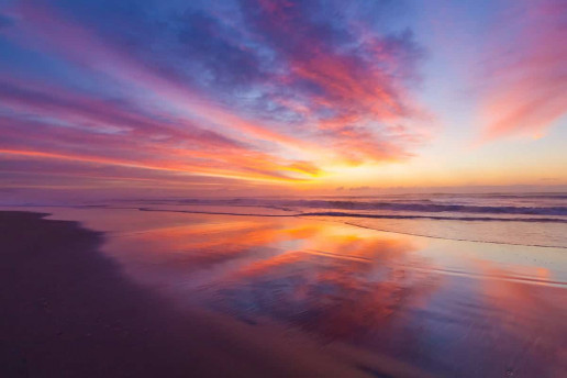 Seven Mile Beach by Andy Hutchinson